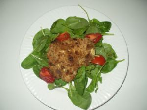Feta-Stuffed Chicken on a bed of spinach
