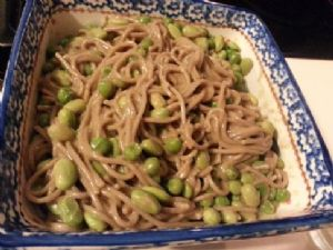 Soba noodles with peas and edamame in peanut sauce