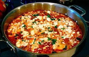 Shakshuka - (poached eggs in spicy tomato sauce)