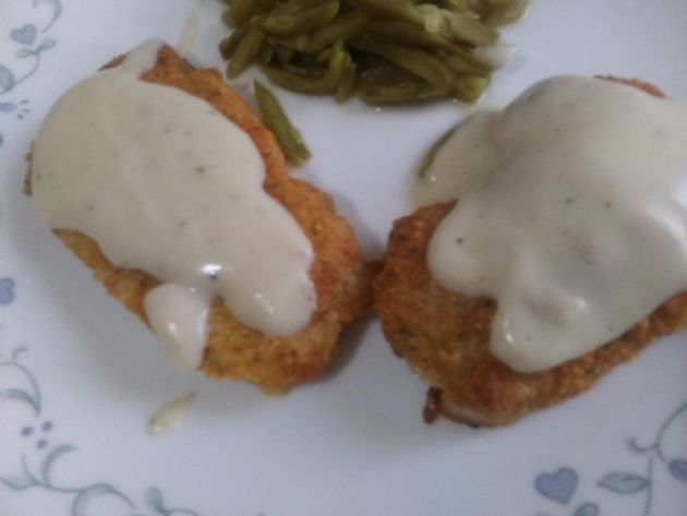 Cajun parmesan crusted Pork cutlets with white gravy