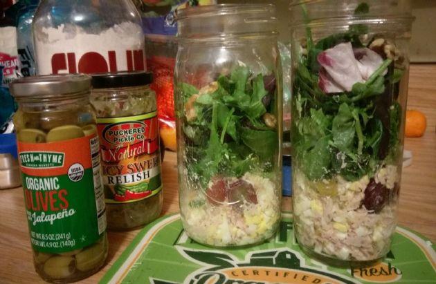 Mixed greens with tuna salad, grapes and walnuts