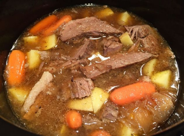 Slow Cooker Pot Roast in Onion Gravy with Potatoes and Baby Carrots