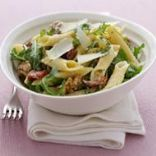 Pasta salad with sun-dried tomatoes, rocket and walnuts