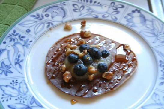 Pancakes topped with Applesauce, Blueberries and Walnuts