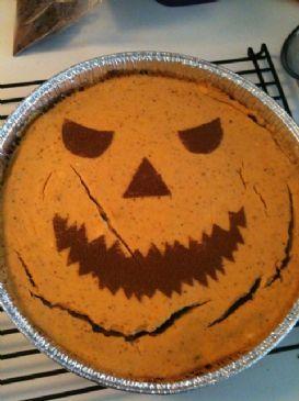Chocolate-Orange-Pumpkin Jack-O-Lantern Layered Cheesecake