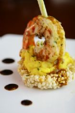 Six Spices king prawn on kaffir lime scented sweet potato mash crispy sticky rice with tom yum emulsion