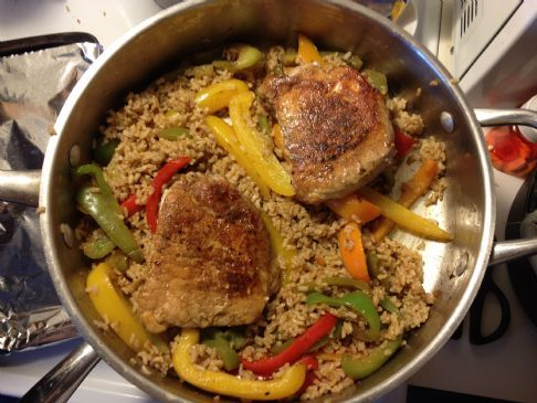 Caribbean Pork Chops with Glazed Bell Peppers and Rice