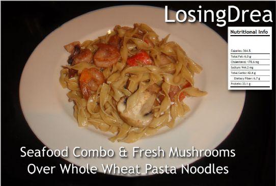 Seafood Combo With Mushrooms Sauteed over Whole Grain Pasta