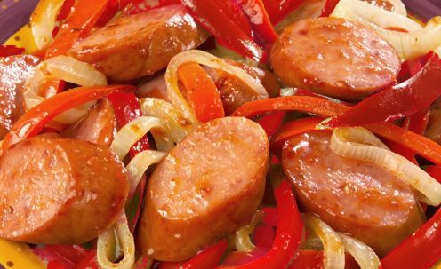 Smoked sausage stir-fry with veal sauce over noodles