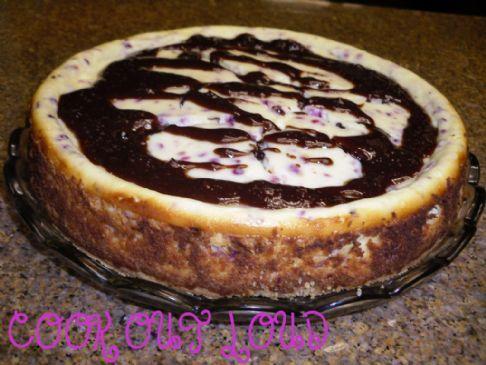 Chocolate Truffle Cran-Orange Cheesecake (by www.cookoutloud.com)