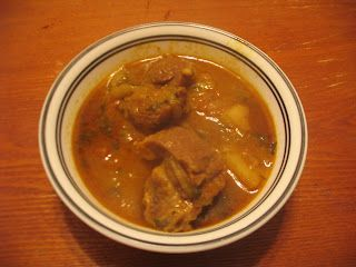 Slow cooked goat meat curry