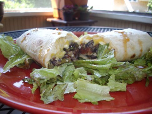 Left Overs Burritos over a bed of lettuces.