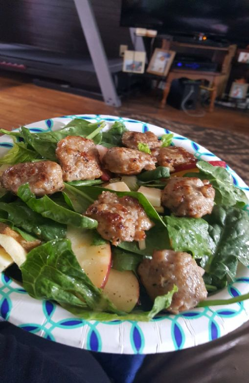 Apple cheddar spinach salad with honey apple vinaigrette with italian sausage