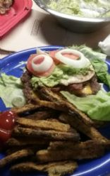 Bacon egg and cheese burger..topped with tomatoe onion and alvacado spread. . Lettuce wrap