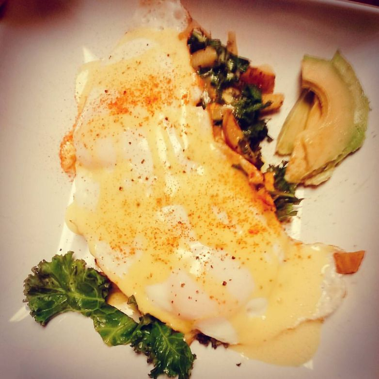 Eggs with Mock Hollandaise Sauce over Sweet Potato and Kale Hash