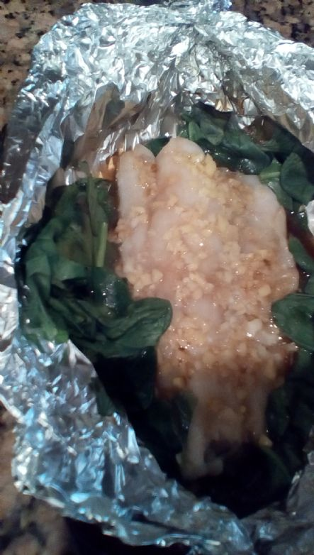 Gingered cod over wilted greens