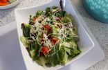 Mixed lettuce, tom, pepper, cuke, rad, and sprouts salad