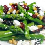Asparagus with pine nuts, cranberries and feta