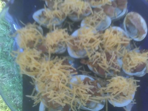 Grilled clams on the half shell