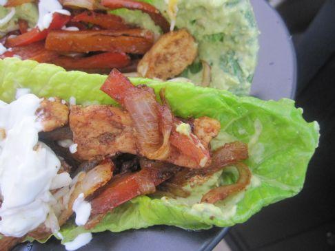 Chicken Fajitas with guacamole and sour cream (sans tortilla shell)