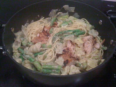 Seared herb-crusted salmon and artichoke pesto linguini