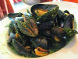 Mussels in a white wine reduction with pesto sauce
