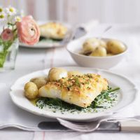 Cheddar Crusted Smoked Haddock with  Jersey Royals & Creme Fraiche Sauce