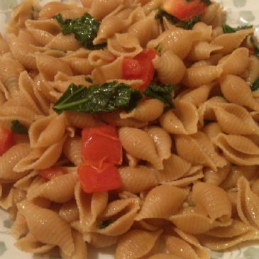 Whole Grain Shells with Kale, Spinach, and Tomato in a Garlic Vegan Butter Sauce