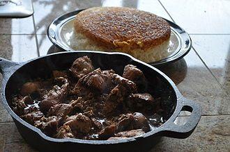 Turkey in Walnut Pomegranate Sauce (Fesenjaan)