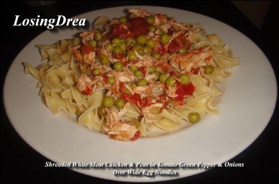 Shreaded Chicken In Tomatoes With Peas Over Wide Egg Noodles