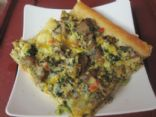 Breakfast pizza with turkey sausage and veggies