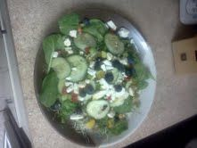 Spinach Salad with Blue berries, feta cheese and sweet sour dressing