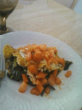 Kale and chicken Omelet topped with chopped tomatoes